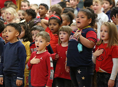 Students singing at Veterans Day concert