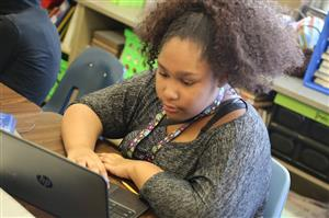Shiloh Middle School student and her Chromebook