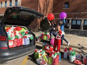 PSH Girl Power Students loading holiday gifts