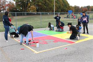 PCSD students painting four-square at Pleasant Valley Elementary