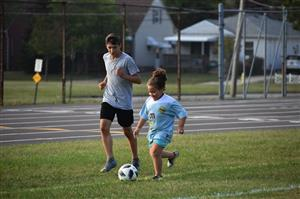 Girl dribbles ball as part of Youth Soccer program